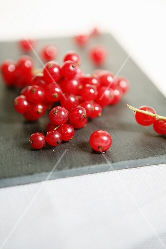Redcurrants on a grey board