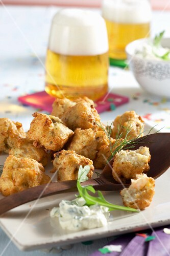 Spicy crab fritters with rocket dip