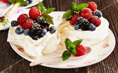 Mini pavlovas filled with cream and berries (Australia)