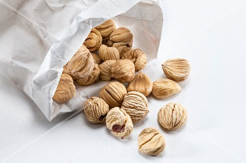Dried chestnuts in a paper bag