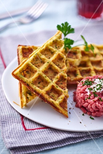 Potato waffles with parsley and beef tatar