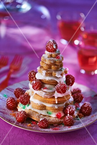 Piece Montee (French celebration cake) with raspberries