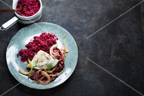 Beetroot risotto with onions and fish