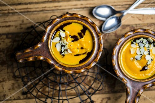 Pumpkin soup with flaked almonds and pumpkin seed oil