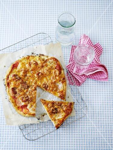 A tomato and mozzarella pizza, sliced