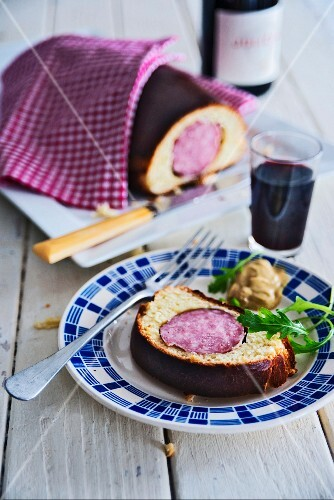Sausage wrapped in brioche with mustard and red wine