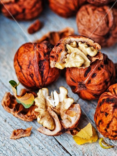 Fresh walnuts, one cracked open