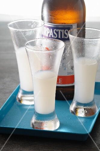Three shots of pastis