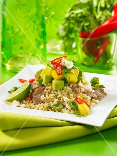 Millet with pork, avocado, mango and chilli