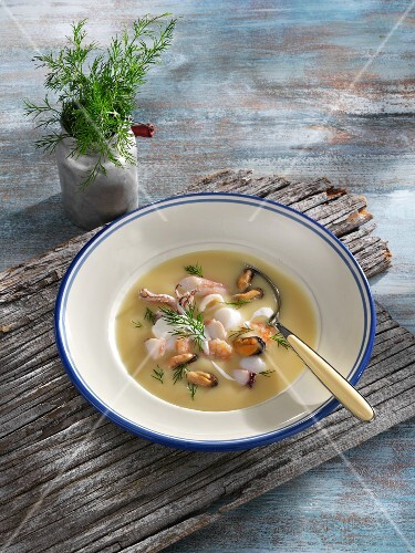 Light celeriac soup with seafood
