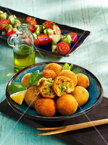 Fried chickpea balls with peas
