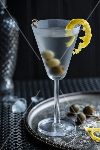 A Martini with olives and lemon zest
