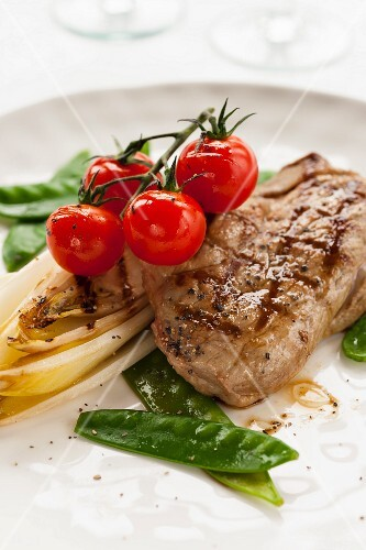 Lamb steak with chicory and cherry tomatoes