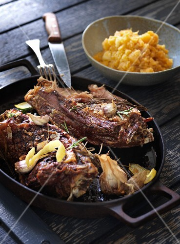 Roast lamb with garlic and rosemary served with mashed kohlrabi