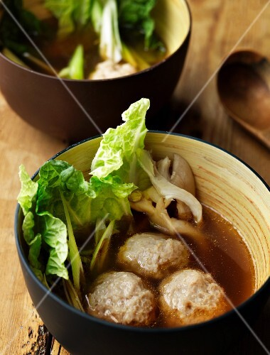 Mushroom soup with meatballs and cabbage leaves
