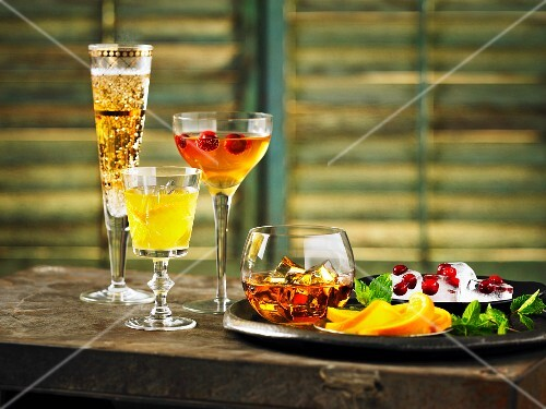 Various drinks and cocktails on a wooden table