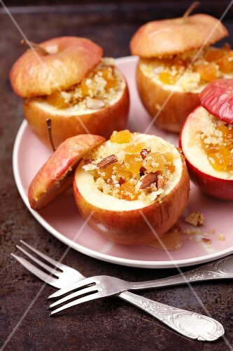 Baked apples with millet, dried apricots, almonds and honey