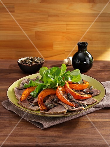 Prime boiled beef with pumpkin and lamb's lettuce