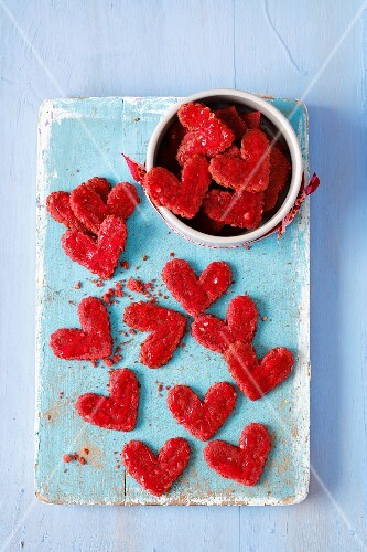 Treats for a dog - hear-shaped biscuits made with beetroot juice, oats, wholemeal flour and beetroot jelly