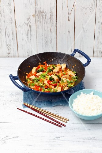 Sweet and sour chicken with broccoli and pepper (Asia)