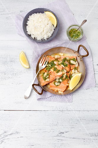 Baked salmon trout with gremolata and rice