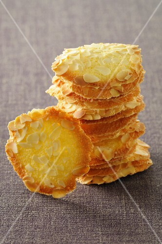 A stack of tuiles with flaked almonds