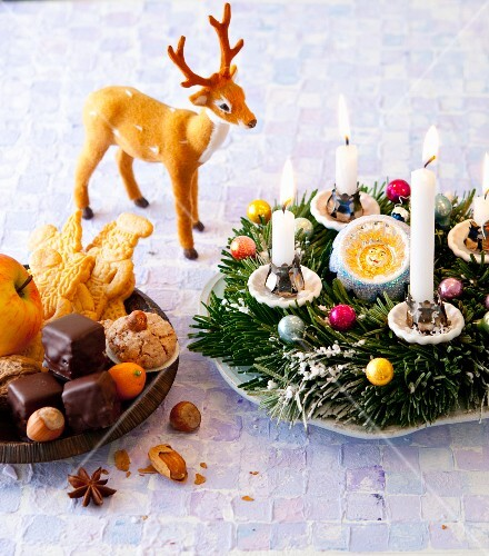 An Advent wreath and a plate of biscuits