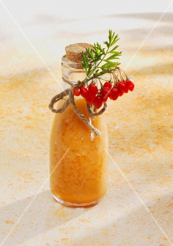 A pineapple and carrot smoothie with orange juice and goji berries