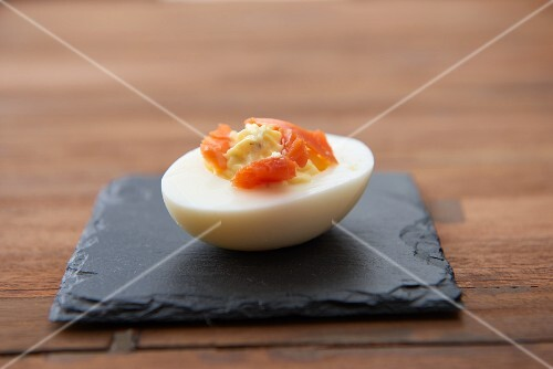 A devilled egg with smoked salmon