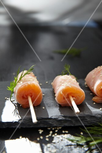 Salmon rolls with horseradish and sesame seeds