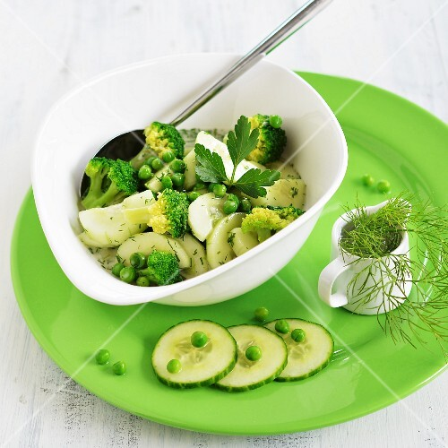 Green salad made from fresh cucumber, broccoli and peas