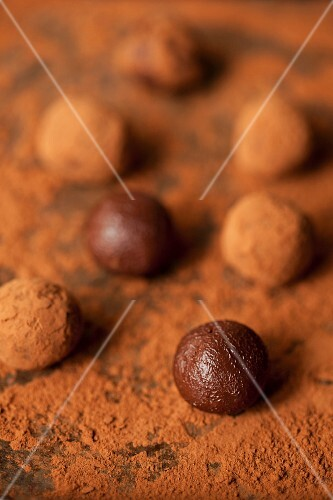 Chocolate truffles being rolled in cocoa powder