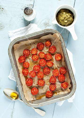 Roasted cherry tomatoes on a baking tray