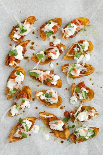 Baked potato skins filled with Indian salad