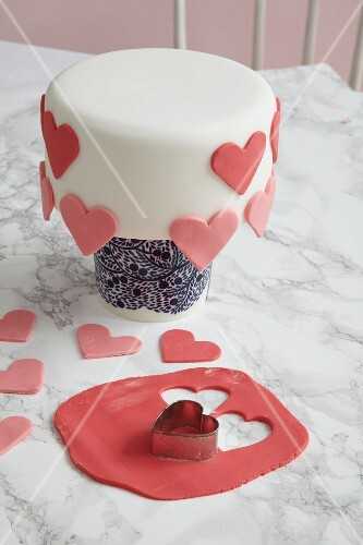 A Madeira cake decorated with overhanging hearts