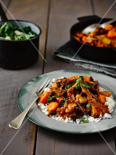 Feijoada (Brazilian stew with beans and meat) on a bed of rice