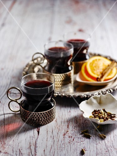 Mulled wine with spices in tea glasses