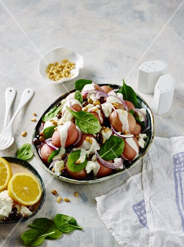 Potato salad with red new potatoes, spinach, feta cheese and pinenuts