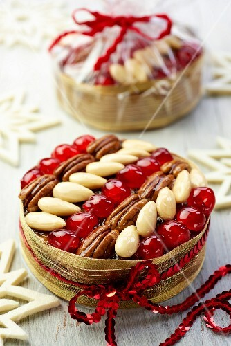 Christmas fruit cakes wiht glace cherries, almonds and pecan nuts as a gift