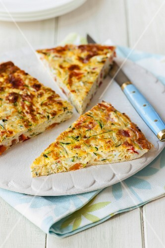 Courgette and tomato frittata, sliced
