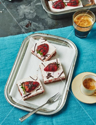 Strawberry cake slices served with coffee