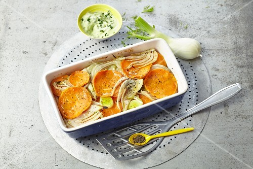 Baked fennel and sweet potatoes with avocado dip