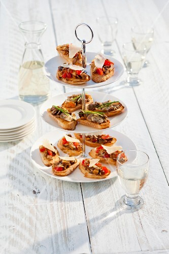 Bruschetta with mushrooms, tomstoes and Parmesan
