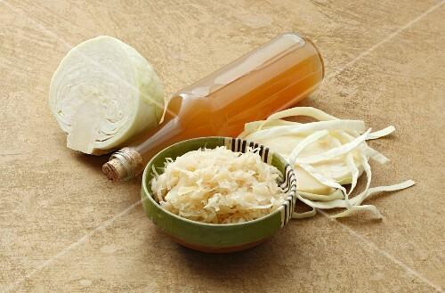 White cabbage, sauerkraut and a bottle of sauerkraut juice