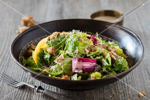 Caesar salad with colourful carrots, wholemeal croutons and beansprouts (low carb)
