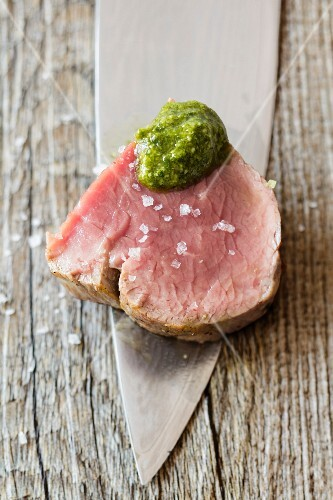 Veal fillet with sea salt and pesto (close-up)
