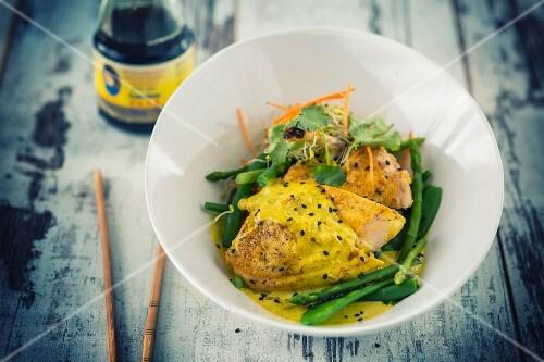 Curried chicken on green vegetables (Vietnam)