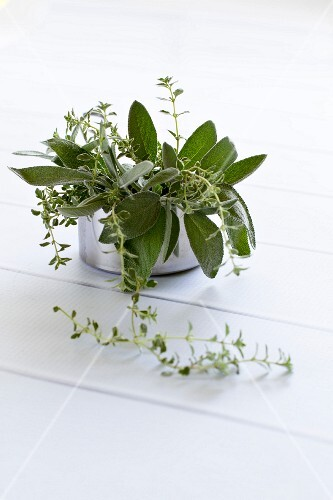 Fresh herbs (sage and thyme) in a metal pot