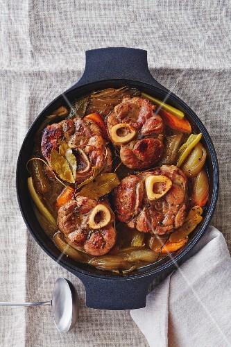 Osso buco with vegetables in a braising dish