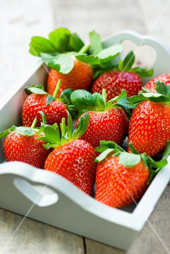 Strawberries in a white wooden tray
